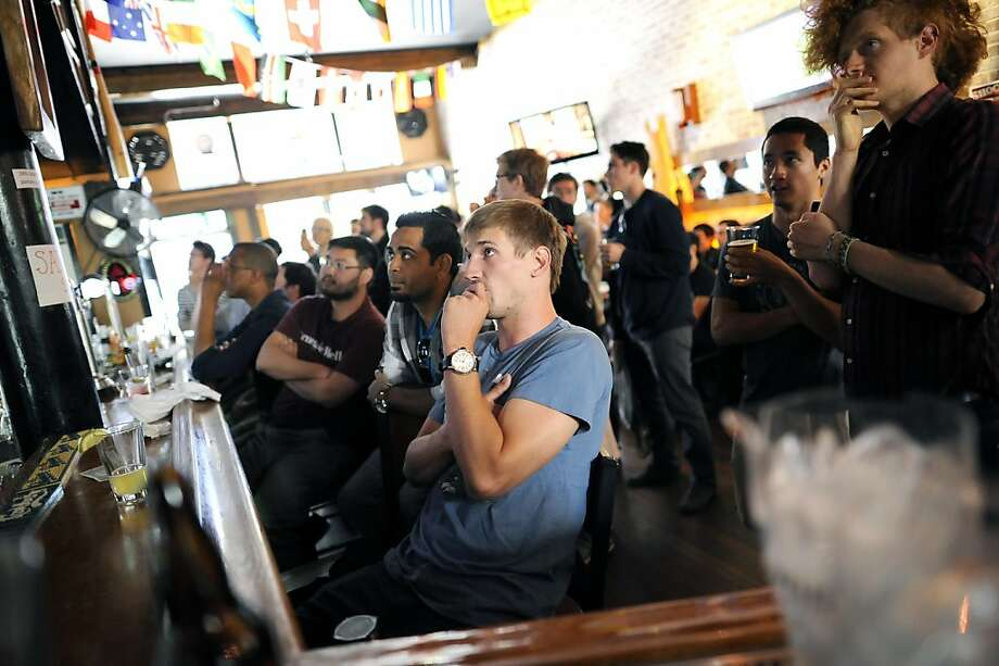 "Just like any broadcast sporting event, the mostly male crowd had their eyes glued to the TVs behind the bar.  ""Barcraft"", a Starcraft video game competition viewing,  was held at Mad Dog in the Fog Pub in San Francisco, CA Sunday August 26th, 2012. Photo: Michael Short, Special To The Chronicle"