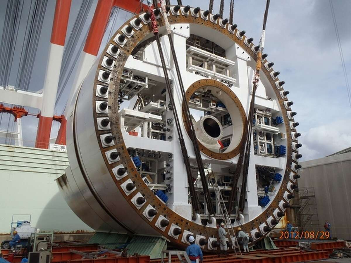 Pictured here is a section of WSDOT's tunneling machine -- the world's largest -- while under construction in Japan.  The machine will be five stories tall and weigh 6,900  tons when finished in late 2012. It will be shipped to Seattle in 41 pieces weighing up to 900 tons each.