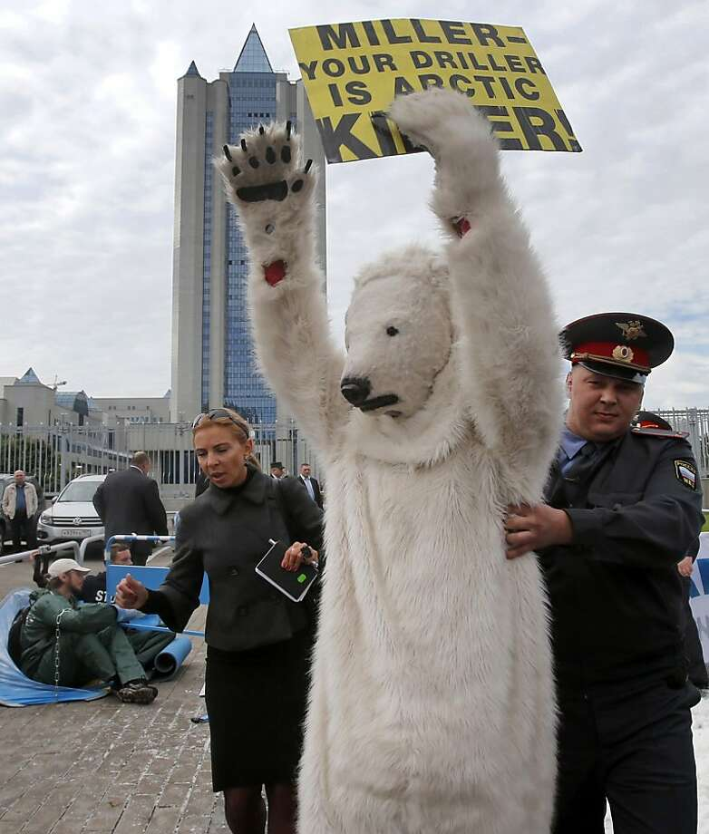 Can you send me to Siberia with Pussy Riot? In Moscow, a police officer arrests a Greenpeace polar bear protesting Gazprom's plans to pioneer oil drilling in the Arctic. Photo: Misha Japaridze, Associated Press