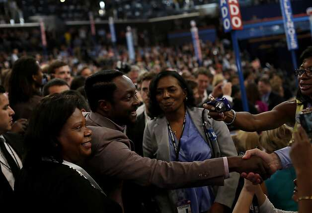 Recording artist Will.i.am greets delegates at the Democratic National Convention (DNC) in Charlotte, North Carolina, U.S., on Tuesday, Sept. 4, 2012. San Antonio Mayor Julian Castro, a Stanford University and Harvard Law School graduate, has the role of first Hispanic keynote speaker at the Democratic National Convention. Photographer: Victor J. Blue/Bloomberg *** Local Caption *** Will.i.am Photo: Victor J. Blue, Bloomberg
