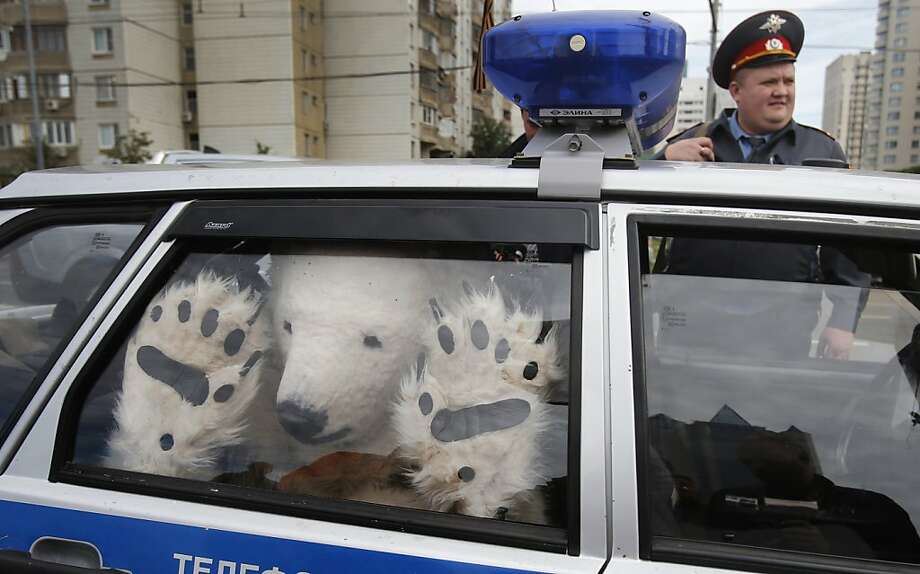 You have the right to remain silent. Anything you growl can be used ...A perpetrator is hauled away by police after being arrested for demonstrating outside Gazprom's headquarters in Moscow. Photo: Misha Japaridze, Associated Press