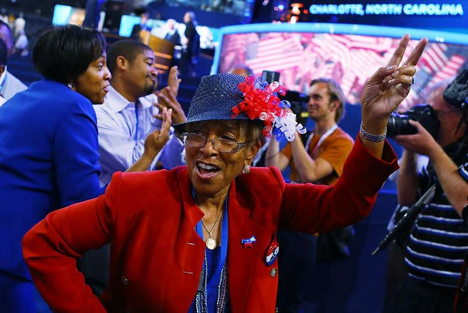 CHARLOTTE, NC - SEPTEMBER 05:  People danice to music on the floor during day two of the Democratic National Convention at Time Warner Cable Arena on September 5, 2012 in Charlotte, North Carolina. The DNC that will run through September 7, will nominate U.S. President Barack Obama as the Democratic presidential candidate. Photo: Joe Raedle, Getty Images