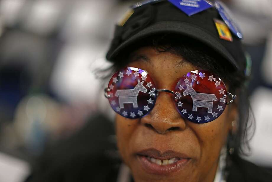 Vivian Stowall of Denver shows off her DNC themed glasses the Democratic National Convention in Charlotte, N.C., on Wednesday, Sept. 5, 2012. Photo: Carolyn Kaster, Associated Press
