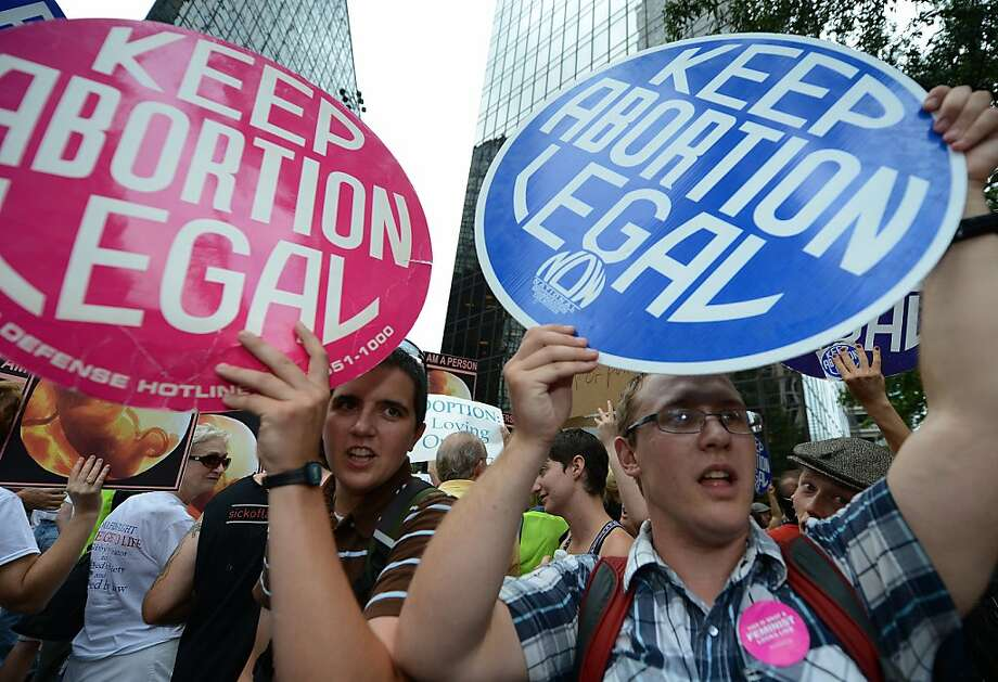Abortion rights activists shout slogans on day two of the  Democratic National Convention (DNC), in Charlotte, North Carolina on September 5, 2012.  President Barack Obama's nomination acceptance speech, originally schecduled to take place at the Bank of America Stadium, will now take place indoors at the Time Warner Cable Arena because of concerns about severe weather, the Democratic National Convention Committee announced. Photo: Robyn Beck, AFP/Getty Images