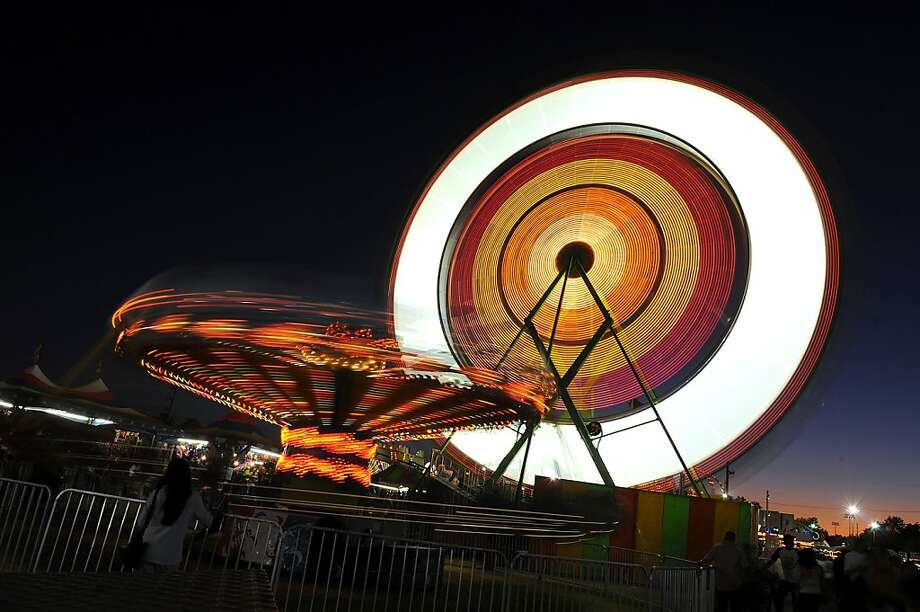 The merry-go-round and Ferris wheel spin at night during 2009's festival. This year's four-day Lodi Grape Festival and Harvest Fair features 37 carnival rides and is expected to draw 80,000 visitors. Photo: Courtesy Lodi News-Sentinel