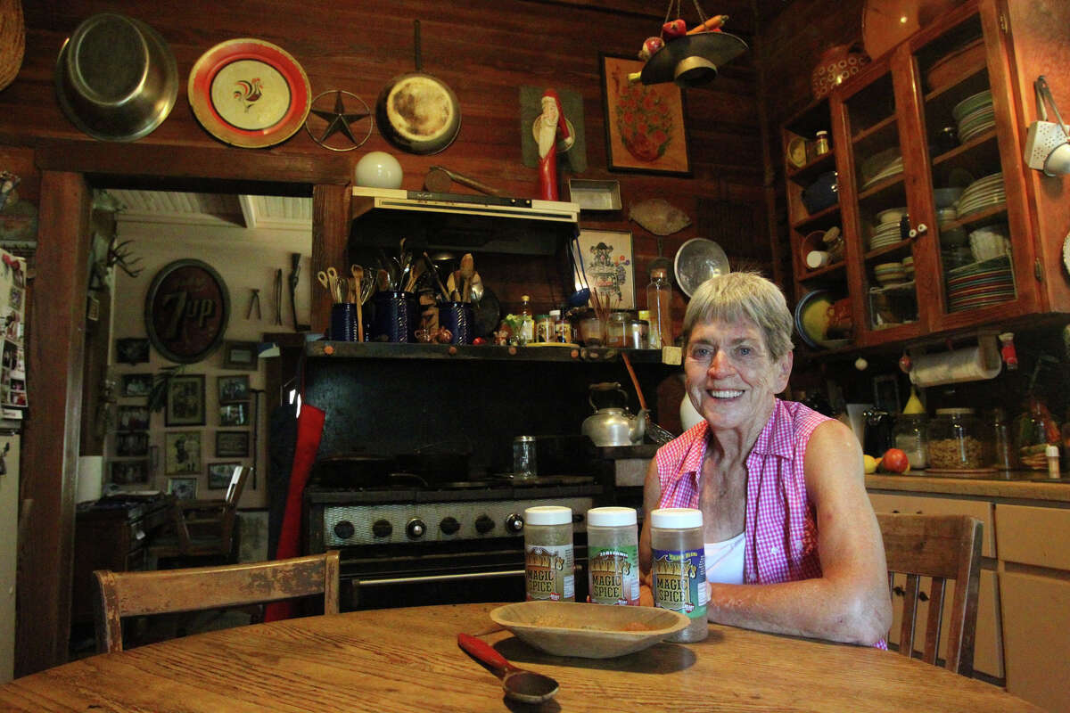 Fran West,77, sits in her kitchen just east of San Antonio Monday July 30, 2012. West recently started her own spice company called Granny's Magic Spice and sells her product in 156 H-E-B stores across Texas. West makes her original spice, an Italian spice and a Cajun style spice. West started her creation in this kitchen. John Davenport/©San Antonio Express-News
