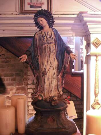 A Madonna statue and candles at The Paris Market in Savannah, Ga. Photo: Diane Cowen
