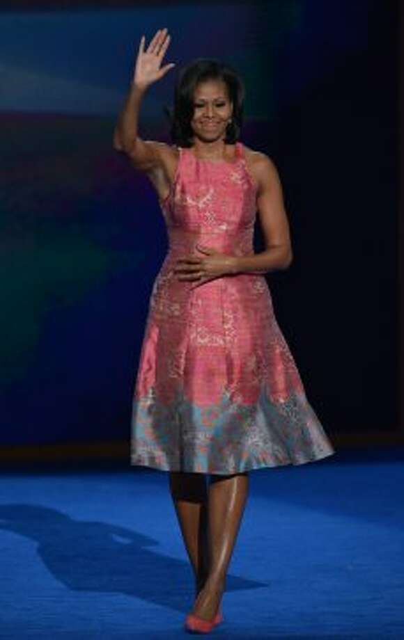 First Lady Michelle Obama acknowledges the crowd, dressed in Tracy Reese, after delivering a speech at the Time Warner Cable Arena in Charlotte, North Carolina, on September 4, 2012 on the first day of the Democratic National Convention (DNC).