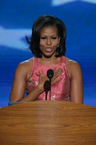 The first lady's manicured nails took center stage during her DNC speech with bloggers attempting to guess the exact color of the grey-blue polish.  (AFP/Getty Images)