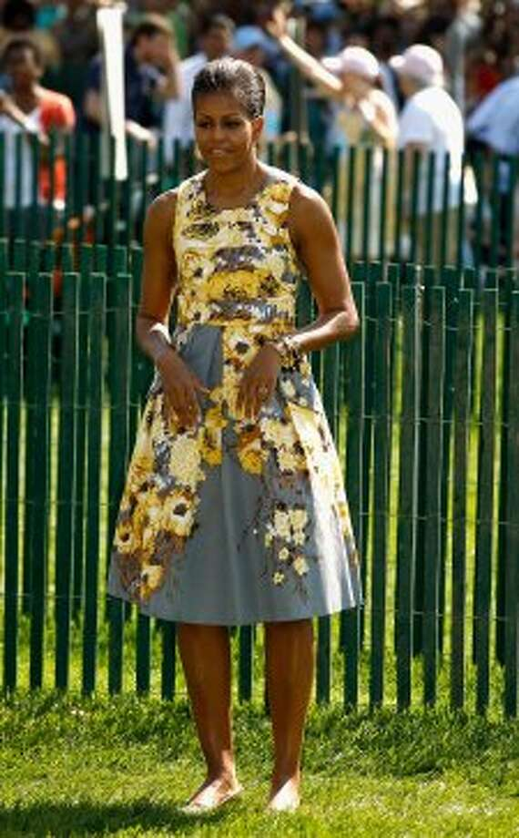 Michelle Obama participates in the official opening of the White House Easter Egg Roll on the South Lawn of the White House April 25, 2011 in Washington, DC, wearing a floral Tracy Reese dress.  (Chip Somodevilla / Getty Images)