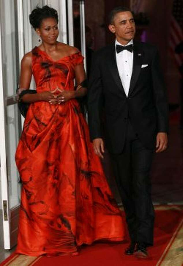President Barack Obama and Michelle Obama arrive to greet Chinese President Hu Jintao prior to a State Dinner at the White House on January 19, 2011. The first lady's bold Alexander McQueen gown was praised by fashion critics.  (Win McNamee / Getty Images)