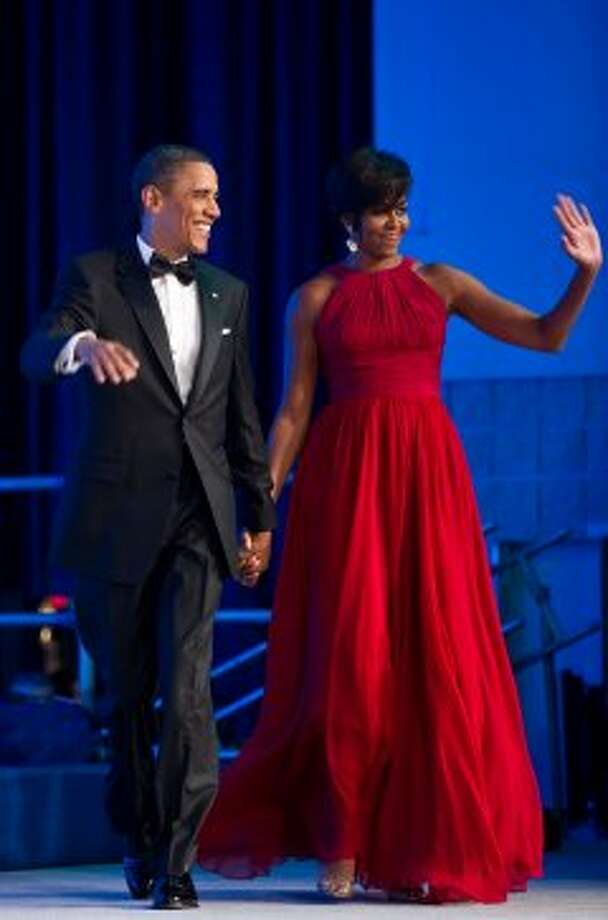 President Barack Obama and Michelle arrive at the annual Congressional Black Caucus Foundation Phoenix Awards dinner in Washington on September 18, 2010.    (NICHOLAS KAMM / AFP/Getty Images)