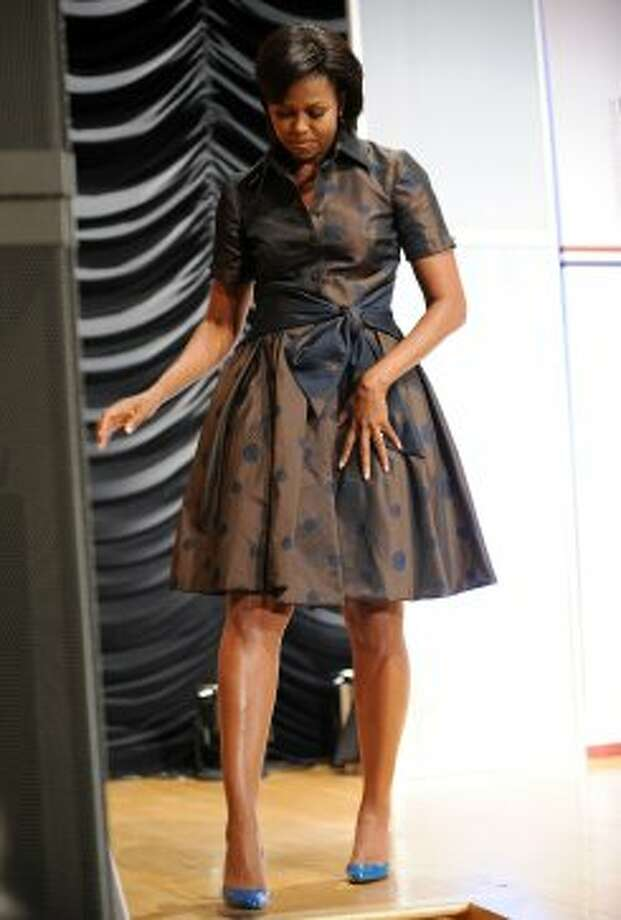 "Michelle Obama leaves after delivering remarks on the ""Let's Move!"" initiative and its goal of solving the challenge of childhood obesity within a generation"" during the 2010 Hispanic Heritage Month events of the Congressional Hispanic Caucus Institute (CHCI) at Ronald Reagan Building and International Trade Center in Washingtion, DC, on September 14, 2010.  (JEWEL SAMAD / AFP/Getty Images)"