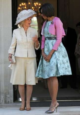Michelle Obama, in a Barbara Tfank dress, speaks to Camilla, The Duchess of Cornwall as they leave Winfield House, in central London, on May 24, 2011.  (JEWEL SAMAD / AFP/Getty Images)