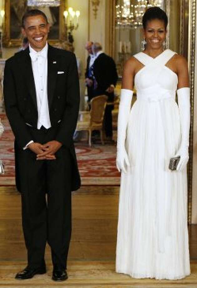President Barack Obama poses with first lady Michelle Obama in the Music Room of Buckingham Palace ahead of a State Banquet on May 24, 2011 in London, England.  (- / AFP/Getty Images)