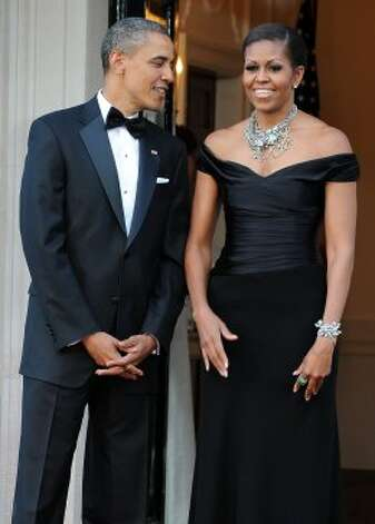 President Obama and first lady Michelle Obama wait to greet Britain's Queen Elizabeth II and Prince Philip, the Duke of Edinburgh for a reciprocal dinner at the Winfield House in London, on May 25, 2011.  (JEWEL SAMAD / AFP/Getty Images)