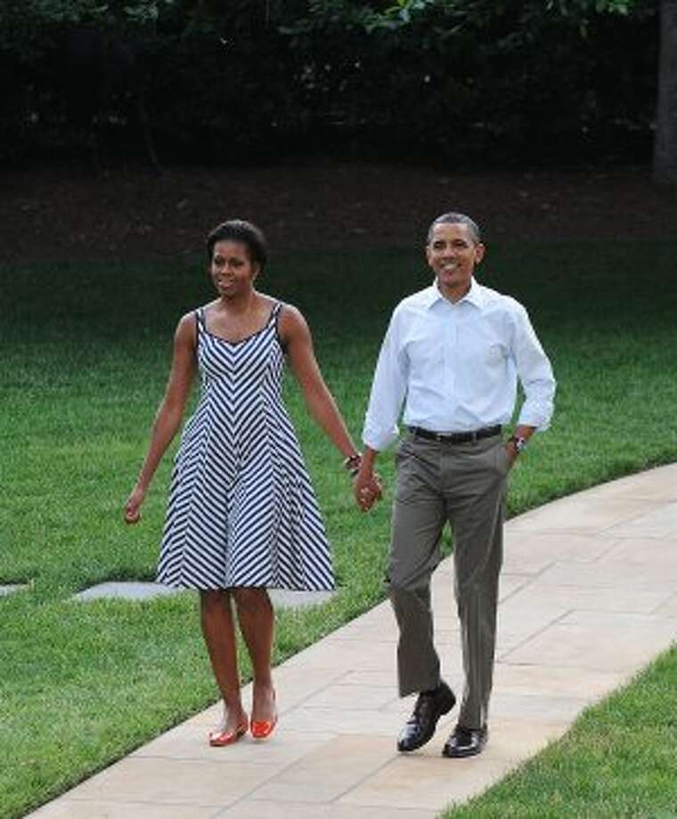 President Obama and first lady Michelle Obama make their way to the Congressional Picnic on the South lawn of the White House, June 15, 2011, in Washington D.C.  (Pool / Getty Images)