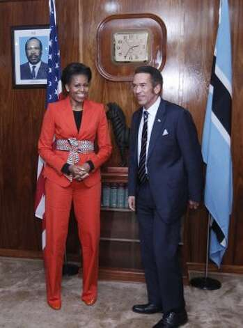 Michelle Obama meets with Botswana's President Lt. Gen. Seretse Khama Ian Khama in Gaborone, Botswana on June 24, 2011.  (CHARLES DHARAPAK / AFP/Getty Images)