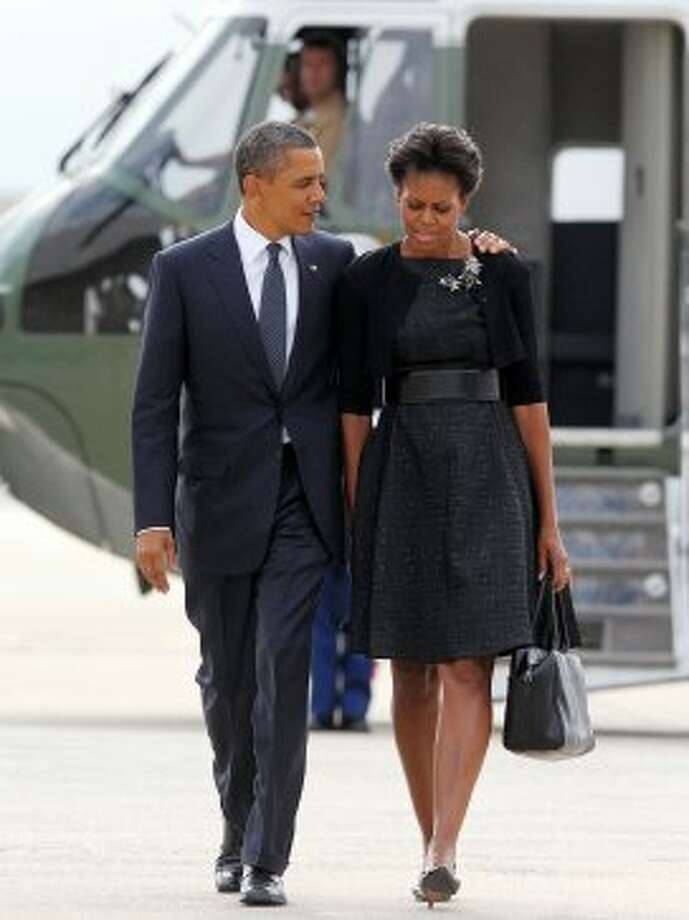 President Barack Obama and first lady Michelle Obama make their way to board Air Force One before departure from John F. Kennedy International Airport in New York City, on September 11, 2011.  (MANDEL NGAN / AFP/Getty Images)