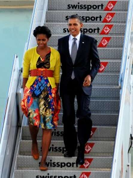 President Obama and first lady Michelle Obama step off Air Force One September 19, 2011 upon arrival