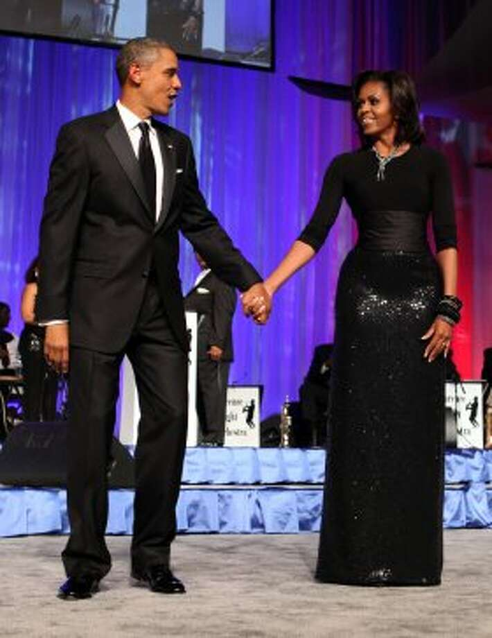 President Barack Obama and Michelle Obama arrive at the Congressional Black Caucus Foundation Annual Phoenix Awards dinner on September 24, 2011 in Washington, DC.   (Pool / Getty Images)