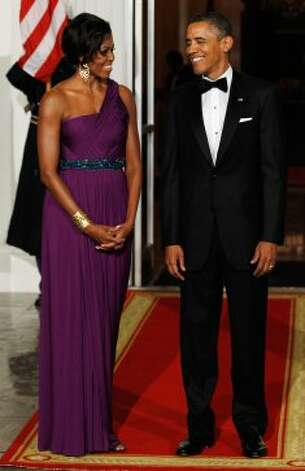 First Lady Michelle Obama and President Obama wait for the arrival of South Korean President Lee Myung-bak and first lady Kim Yoon-ok on the North Portico of the White House before attending a State Dinner October 13, 2011 in Washington, DC.  (Alex Wong / Getty Images)
