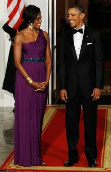 First Lady Michelle Obama and President Obama wait for the arrival of South Korean President Lee Myu