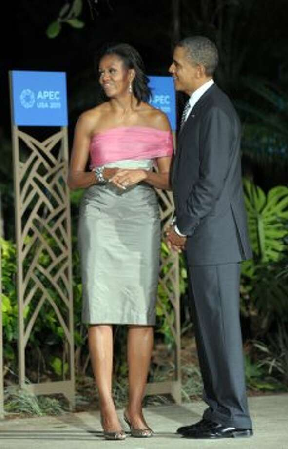President Obama and Michelle Obama, in custom-designed Vera Wang, wait for leaders to arrive for the Asia-Pacific Economic Cooperation (APEC) summit leaders' dinner in Honolulu, Hawaii, on November 12, 2011.  (JIM WATSON / AFP/Getty Images)