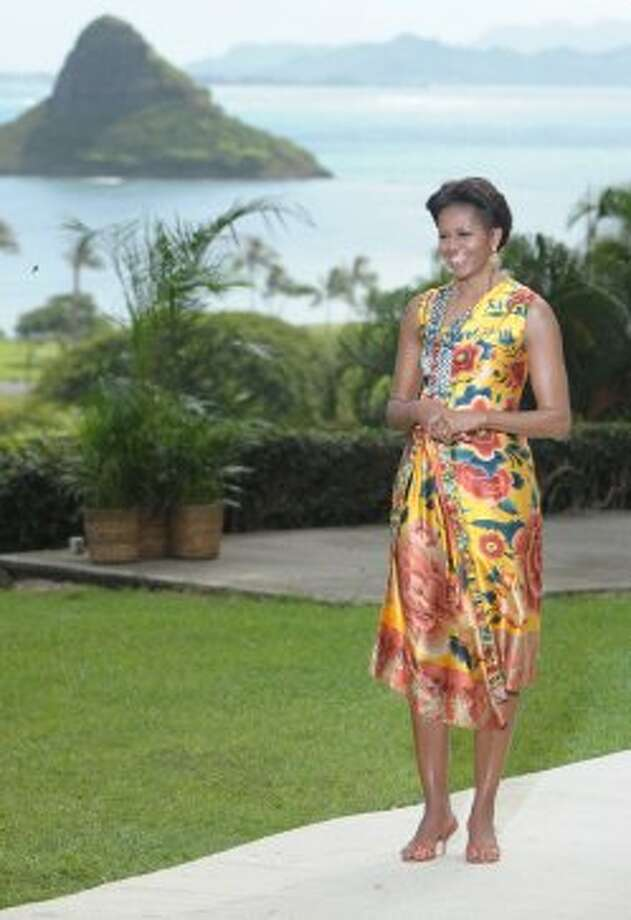 First lady Michelle Obama waits to greet the wives of various leaders as she hosts Asia-Pacific Economic Cooperation (APEC) leaders' spouses luncheon at Kualoa Ranch in Ka'a'awa on the island of Oahu in Hawaii on November 13, 2011.  (SAUL LOEB / AFP/Getty Images)
