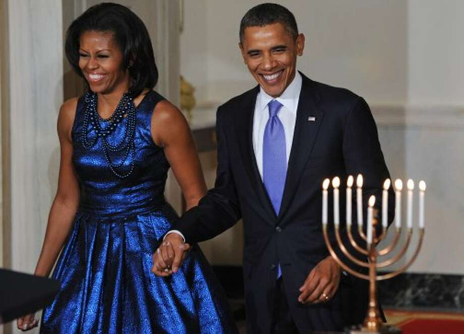 President Obama and first lady Michelle Obama arrive for a Hanukkah reception on December 8, 2011 in the Grand Foyer of the White House in Washington.    (MANDEL NGAN / AFP/Getty Images)