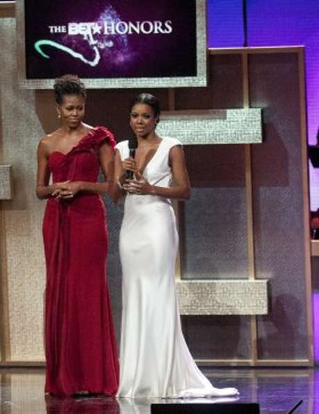 Michelle Obama and Gabrielle Union speak during the BET Honors 2012 at the Warner Theatre on January