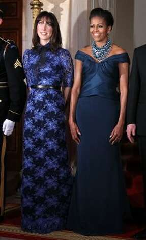 First Lady Michelle Obama (R), wearing a Marchesa gown, and Samantha Cameron (L), wife of British Prime Minister David Cameron, pose for a photo at the Grand Staircase of the White House on March 14, 2012. (Alex Wong / Getty Images)