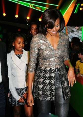 Sasha Obama, Michelle Obama and Malia Obama at Nickelodeon's 25th Annual Kids' Choice Awards on March 31, 2012 in Los Angeles, California. The First Lady's sparkly top is by American designer Wes Gordon.  (Kevork Djansezian / Getty Images)