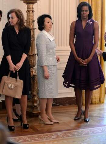 First Lady Michelle Obama (R), French first lady Valerie Trierweiler (L) and Japan's Prime Minister Yoshihiko Noda's wife Hitomi (C) stand in the East Room during a tour of the White House in Washington, DC, on May 19, 2012.  (AFP/Getty Images)