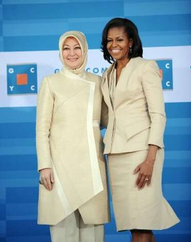 Michelle Obama (R) greets Mrs. Hayrunnisa Gul from Turkey at the Gary Corner Youth Center in Chicago, on May 20, 2012.  (OLIVIER DOULIER / AFP/Getty Images)
