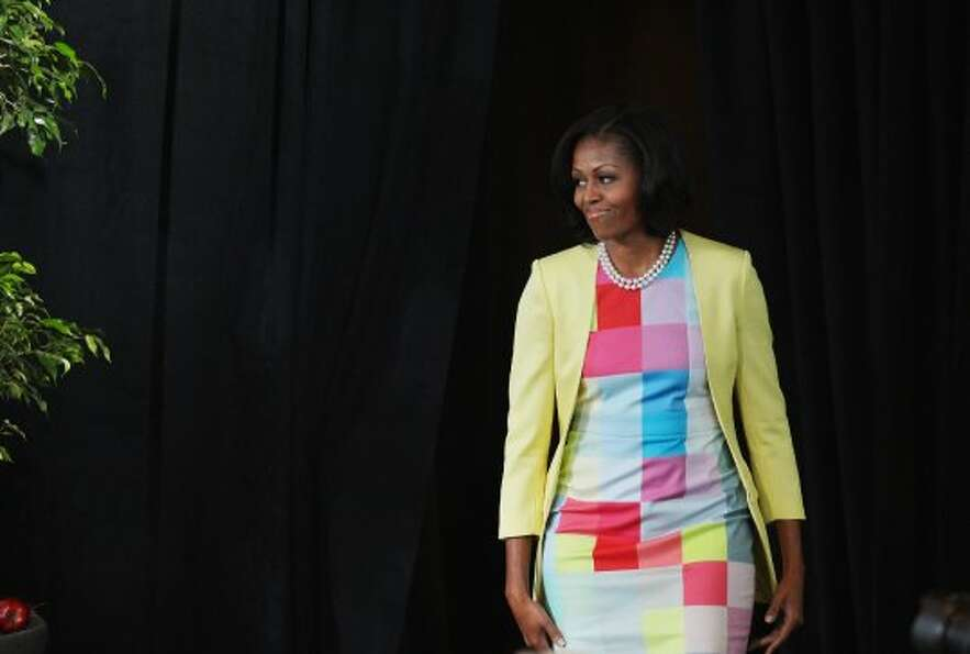 Michelle Obama arrives for a press conference to announce changes to Disney's nutrition guideline po