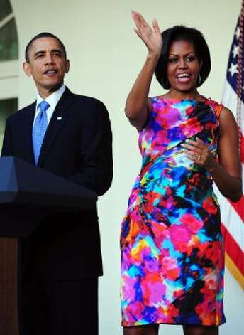 President Barack Obama and First Lady Michelle Obama acknowledge traditional Mexican performers as Obama speaks at a Cinco de Mayo reception in the Rose Garden at the White House in Washington, DC, on May 5, 2010. (JEWEL SAMAD / AFP/Getty Images)