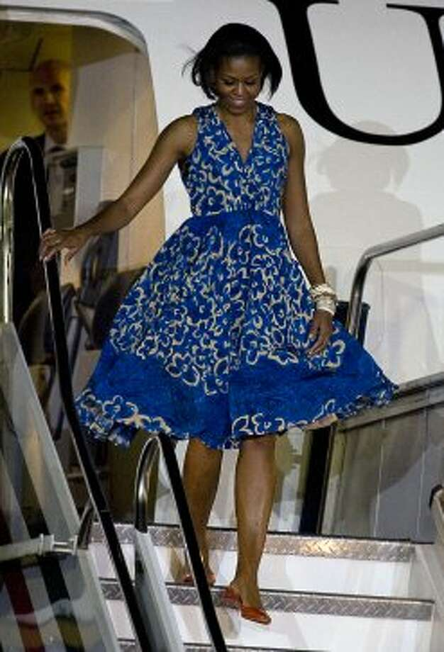 Michelle Obama walks out of the plane upon arrival at the Benito Juarez International Airport in Mexico City, on April 13, 2010.  (LUIS ACOSTA / AFP/Getty Images)