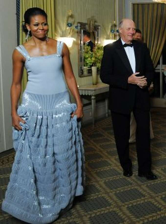 First Lady Michelle Obama follows (unseen) President and Nobel Peace Prize laureate Barack Obama as they arrive at the Nobel Banquet in Oslo on December 10, 2009.  (JEWEL SAMAD / AFP/Getty Images)