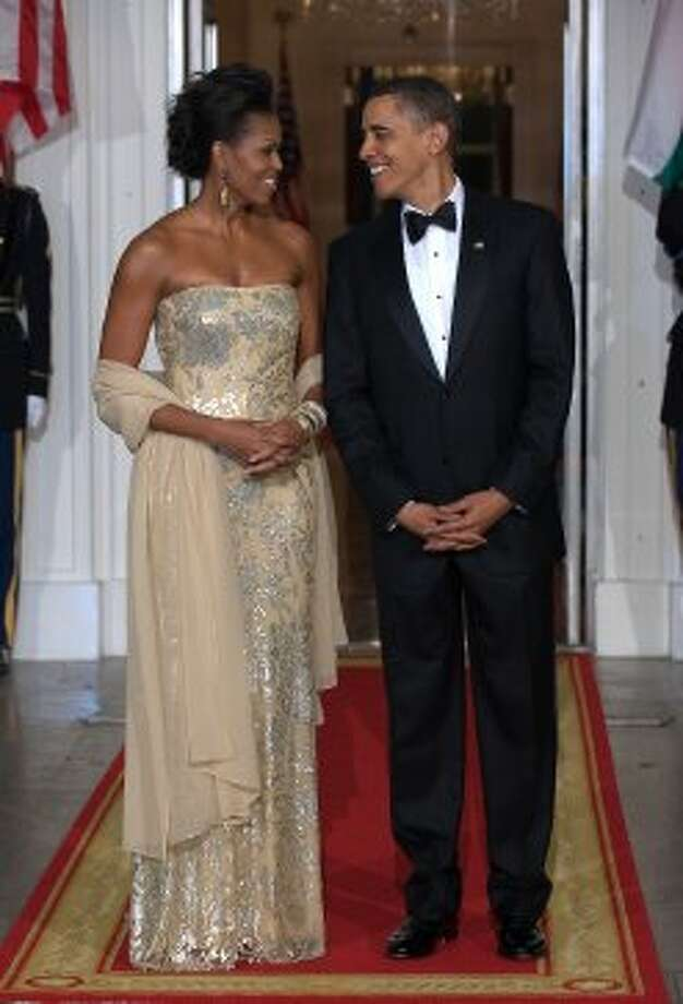 President Obama stands with First Lady Michelle Obama shortly before greeting Indian Prime Minister Manmohan Singh and his wife Gursharan Kaur at the North Portico of the White House November 24, 2009. (NICHOLAS KAMM / AFP/Getty Images)