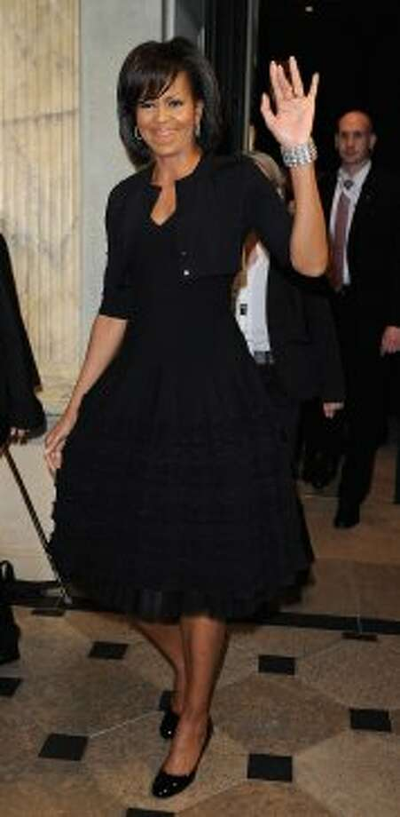 First Lady Michele Obama waves as she arrives to attend the spouses evening on April 3, 2009 in Baden Baden, Germany. (Pascal Le Segretain / Getty Images)