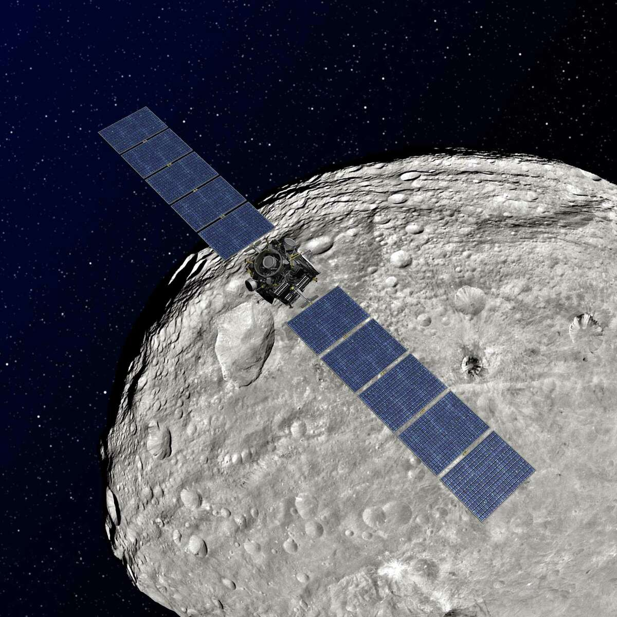 An artist rendering depicts the Dawn spacecraft in orbit around the giant asteroid Vesta. Dawn is now heading to Ceres, another dwarf planet