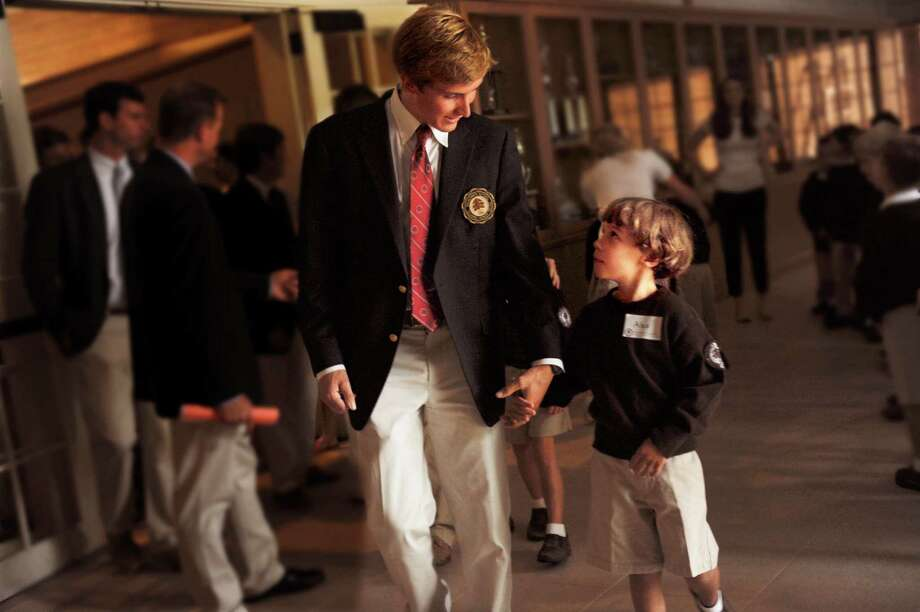 Senior Matthew Podlesak with Alex Ohls during the first day of school Brunswick has a tradition, for the Upper School Big Brothers walk hand-in-hand with their Lower School Little Brothersin an effort to show leadership, mentorship and friendship Wednesday, Sept. 5, 2012. Photo: Helen Neafsey / Greenwich Time