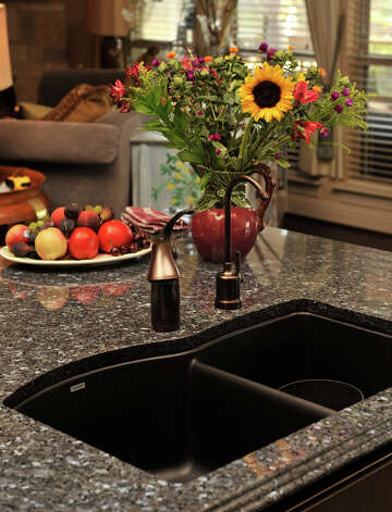 In addition to the range of colors and patterns, the durability of granite makes it a top choice for kitchen counters. Blue Pearl is a popular pattern. Photo: Express-News File Photo