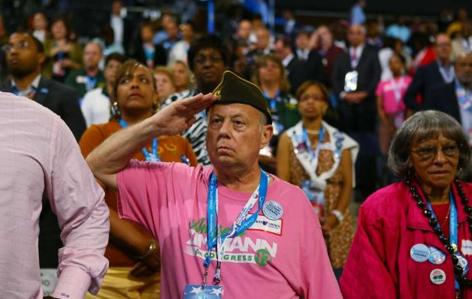 CHARLOTTE, NC - SEPTEMBER 05:  A man salutes during day two of the Democratic National Convention at Time Warner Cable Arena on September 5, 2012 in Charlotte, North Carolina. The DNC that will run through September 7, will nominate U.S. President Barack Obama as the Democratic presidential candidate.  (Joe Raedle / Getty Images)
