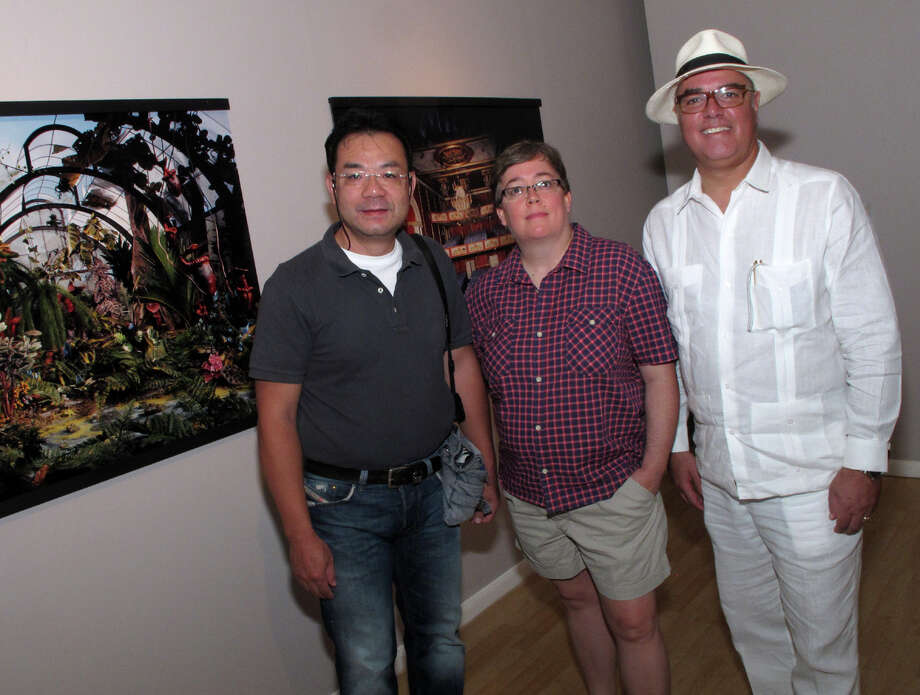 OTS/HEIDBRINK - Artists Shen Chao-Liang, from left, Lori Nix and City of San Antonio Office of Cultural Affairs director Felix Padron gather at the opening reception for Fotoseptiembre USA 2012 Signature Exhibits at the Instituto Cultural de Mexico on 9/1/2012. This is #3 of 3 photos. names checked photo by leland a. outz Photo: LELAND A. OUTZ, SPECIAL TO THE EXPRESS-NEWS / SAN ANTONIO EXPRESS-NEWS