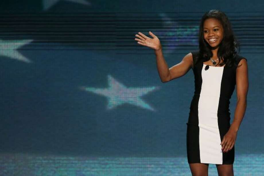 CHARLOTTE, NC - SEPTEMBER 05:  Olympic gymnast Gabby Douglas waves after leading the Pledge of Allegiance during day two of the Democratic National Convention at Time Warner Cable Arena on September 5, 2012 in Charlotte, North Carolina. The DNC that will run through September 7, will nominate U.S. President Barack Obama as the Democratic presidential candidate.   (Alex Wong / Getty Images)