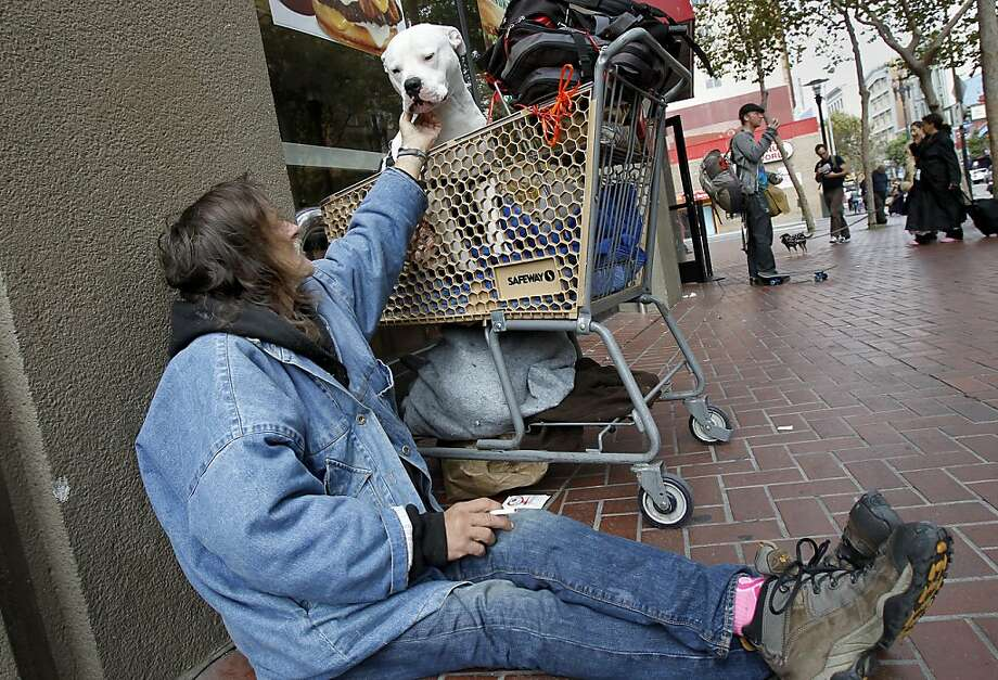 Richard, a homeless man, sat U.N. Plaza with his dog Kane. Photo: Brant Ward, The Chronicle