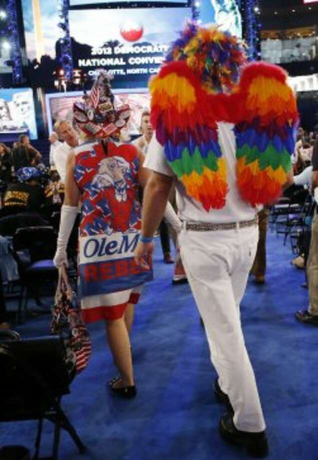 Mississippi delegates Kelly Jacobs from Hernando, left, and Renick Taylor from Biloxi  arrive at the Democratic National Convention in Charlotte, N.C., on Wednesday, Sept. 5, 2012.  (Jae C. Hong / Associated Press)