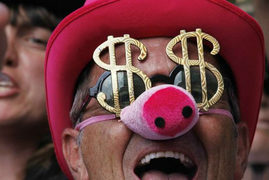 A Code Pink demonstrator chants outside the Charlotte Convention Center during a protest march, Wednesday, Sept. 5, 2012, in Charlotte, N.C., during the second day of the Democratic National Convention.   (Gerry Broome / Associated Press)